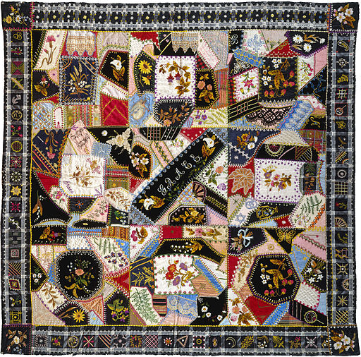 A 'crazy quilt'- a quilt in a random and chaotic pattern