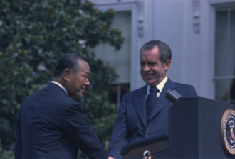 Kakuei Tanaka - Tanaka shook hands with similarly embattled President Richard Nixon during a Washington visit in July 1973.