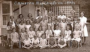 Anne Griffith-Jones - Tanglin Boarding School, Cameron Highlands: Griffith-Jones (back row, fifth from left) with her staff and pupils outside the school's main building. Photo credit: Tanglin Trust School.
