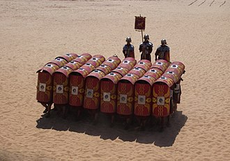 Testudo formation - The testudo formation in a Roman military reenactment.