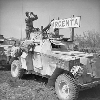 Battle of the Argenta Gap - Men of 56th Reconnaissance Regiment, of 78th Division, with a Humber Light Reconnaissance Car in Argenta, 18 April 1945.