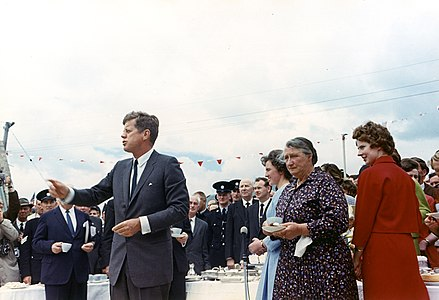 The President greets relatives at a tea held at the home of Mrs. Mary Ryan.jpg