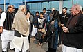 The Prime Minister, Shri Narendra Modi meeting the family members of late Shri Mufti Mohammad Sayeed, at Palam Airport, in New Delhi on January 07, 2016. The Union Home Minister, Shri Rajnath Singh is also seen.jpg