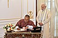 The Prime Minister of Bhutan, Mr. Tshering Tobgay signing the visitors' book, at Hyderabad House, in New Delhi on July 06, 2018. The Prime Minister, Shri Narendra Modi is also seen.JPG