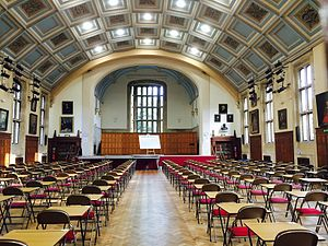 The King's School, Canterbury - The Shirley Hall was built on the site of the tennis courts and opened by the Queen Mother in 1957. Assemblies, plays, concerts and public examinations all take place here. Underneath the Hall is the Pupils' Social Centre