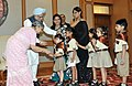 The school children tied 'Rakhi' to the Prime Minister, Dr. Manmohan Singh, on the occasion of 'Raksha Bandhan', in New Delhi on August 24, 2010.jpg