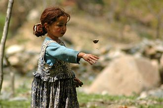 Child labour in Africa - A Berber shepherd girl in the Atlas Mountains of Morocco.