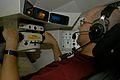 Tim Murphy uses a M1A1 Abrams tank simulator.jpg