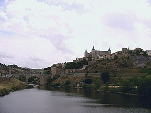 Artificio de Juanelo - A modern view of the Tagus by Toledo. The Alcázar is on top.