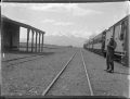Train at Waiouru Railway Station, with Mount Ruapehu in the background ATLIB 308244.png