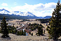 Train heads west into the Crowsnest Pass.JPG