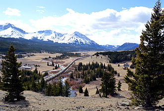 Crowsnest Pass - A train heads west toward the summit of the Crowsnest Pass from Coleman, Alberta.