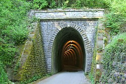 Western side of the old railway tunnel built in 1901, now converted to a bicycle route