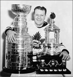 Turk Broda - Broda (pictured in 1948), with the Stanley Cup and Vezina Trophy