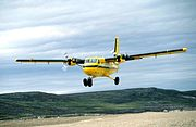 Twin Otter taking off from a gravel airstrip near Sila Lodge at Wager Bay (Ukkusiksalik National Park, Nunavut, Canada)
