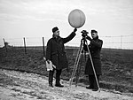 Two corporals of an RAF mobile meteorological unit prepare to send up a balloon to measure the wind speed and cloud height, 2 January 1940. C307.jpg