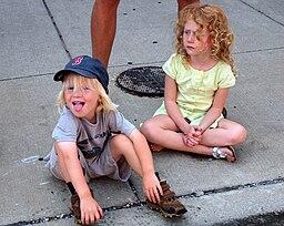 Two girls sitting on a sidewalk - 20090915