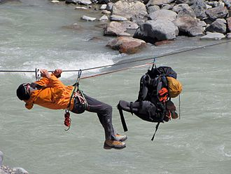 Tyrolean traverse - Climber uses tyrolean traverse to cross a Rio Fitz Roy in Argentina