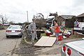 U.S. Air Force Senior Airman Clay Coppage, left, assigned to the 34th Combat Communications Squadron at Tinker Air Force Base, Okla., assists in the cleanup effort May 25, 2013, in Moore, Okla 130525-Z-VF620-4092.jpg