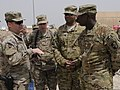 U.S. Army Brig. Gen. Steven Shapiro, left, the deputy commanding general for the 1st Sustainment Command, speaks to Chief Warrant Officer 3 Darran Wiggins, right, and other senior logisticians at Bagram Airfield 130612-A-KO462-024.jpg