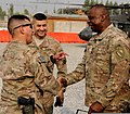 U.S. Army Gen. Lloyd Austin III, right, the commander of U.S. Central Command, exchanges greetings with Command Sgt. Maj. Noe Salinas, left, the senior enlisted adviser for the 4th Brigade Combat Team, 10th 131006-A-CB167-002.jpg