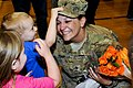 U.S. Army Spc. Bozena Weber, animal care specialist with the 438th Medical Detachment (Veterinary Service), 10th Combat Support Hospital, reunites with her son, Derek, and daughter, Danica, at the Special Events 130321-A-UK001-004.jpg