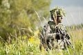 U.S. Army Spc. Shane Yuknis, a Cavalry scout with Bravo Troop, 1st Squadron, 172nd Cavalry Regiment, 86th Infantry Brigade Combat Team, Vermont Army National Guard, surveys his surroundings during an air assault 130813-Z-KE462-058.jpg