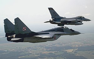 U.S. F-16C Fighting Falcon and Polish Mikoyan-Gurevich MiG-29A over Krzesiny air base, Poland - 20050615.jpg