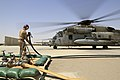 U.S. Marine Corps Lance Cpl. Gage Cusker, a nozzle operator with Marine Wing Support Squadron (MWSS) 274, prepares to attach a fuel hose to a CH-53E Super Stallion helicopter at a forward arming and refueling 140903-M-EN264-163.jpg
