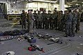 U.S. Marine Corps Sgt. Daniel Knight, a nonlethal weapons instructor with Special Purpose Marine Air-Ground Task Force South, speaks to Peruvian marines during a tour of the amphibious assault ship USS America 140901-M-HB658-138.jpg