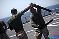 U.S. Marine Corps Staff Sgt. Daniel Ahmed, right, and Sgt. Michael Triplett, with Security Cooperation Task Force Africa Partnership Station (APS) 2012, practice Marine Corps Martial Arts Program techniques on 120804-M-JU449-154.jpg