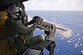 U.S. Navy Aircrewman 3rd Class Bobby Heimovitz, assigned to Helicopter Sea Combat Squadron (HSC) 9, fires a .50-caliber machine gun at an MK-25 smoke target in the Atlantic Ocean, Sept 120906-N-UK248-051.jpg