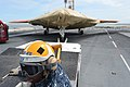 U.S. Navy Aviation Boatswain's Mate (Equipment) 3rd Class Audley Campbell prepares to move a Navy X-47B Unmanned Combat Air System demonstrator aircraft on the flight deck of the aircraft carrier USS George H.W 130506-N-FU443-332.jpg