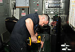 U.S. Navy Electrician's Mate 3rd Class Stephen McGiverin performs maintenance on a door to the electrical shop on the guided missile frigate USS Underwood (FFG 36) during Operation Martillo and Southern 120901-N-ZE938-014.jpg