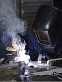 U.S. Navy Hull Maintenance Technician 2nd Class Neil Hopkins performs a welding procedure in the machine shop aboard the aircraft carrier USS Nimitz (CVN 68) April 10, 2013, in the Pacific Ocean 130410-N-TW634-190.jpg