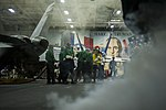 U.S. Sailors fight a simulated fire during a general quarters drill in the hangar bay of the aircraft carrier USS Harry S. Truman (CVN 75) March 8, 2014, in the Gulf of Oman 140308-N-VE959-037.jpg