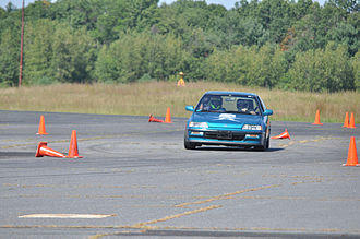 "Autocross - Drivers must navigate a series of ""turns"" defined by traffic cones."