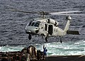 """US Navy 020924-N-9593M-026 A SH-60 """"Sea Hawk"""" Helicopter assigned to Helicopter Combat Support Squadron Five (HC-5) prepares to receive a sling loaded pallet.jpg"""