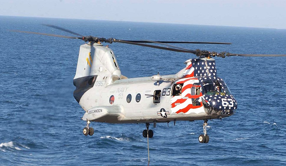 US Navy 030315-N-8497H-003 A CH-46 Sea Knight assigned to Helicopter Transport Squadron Eleven (CH-11) lifts cargo during a vertical replenishment (VERTREP)