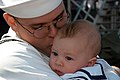 US Navy 030506-N-1002W-003 A sailor aboard USS Abraham Lincoln (CVN 72) embraces his son for the first time.jpg