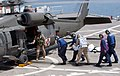 US Navy 030525-N-6967M-084 An Iraqi civilian is loaded on an Army Blackhawk Helicopter, after receiving medical aid for injuries aboard the hospital ship USNS Comfort (T-AH 20).jpg
