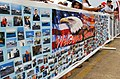 US Navy 030529-N-6607P-002 Family members of Sailors aboard the USS Theodore Roosevelt (CVN 71) display a welcome home banner on Naval Station Norfolk pier.jpg