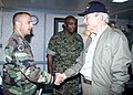 US Navy 030827-N-2954M-114 Senate Armed Services Committee Chairman Sen. John Warner (R-Va.), right, greets Army Sgt. Maj. Lawrence Lane, assigned to Joint Task Force Liberia.jpg