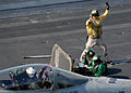 US Navy 031122-N-9742R-001 A shooter signals to the pilot.jpg