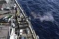 US Navy 040330-N-3874J-001 Sailors aboard the Whidbey Island-class amphibious dock landing ship USS Comstock (LSD 45) fire a 50. Caliber machine gun.jpg