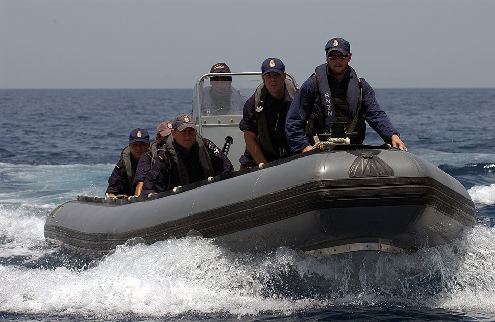 US Navy 040506-N-7586B-314 Sailors assigned to boarding team from the New Zealand frigate HMNZS Te Mana (F 111) man a Rigid Hull Inflatable Boat (RHIB) to conduct a search of fishing dhows in the area