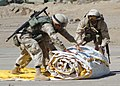 US Navy 040523-N-1261P-021 Seabees assigned to Naval Mobile Construction Battalion Seven Four (NMCB-74) unroll a twelve-man tent.jpg