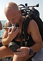 US Navy 040805-N-4374S-006 Senior Chief Aviation Ordnanceman Paul Sabato assigned to the Explosive Ordnance Disposal Mobile Unit Four (EODMU-4) checks the pressure gauge on his dive gear prior to conducting a reconnaissance and.jpg
