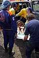 US Navy 050112-N-6074Y-154 Spanish doctors load an injured Indonesian woman into an emergency vehicle for transportation to the hospital at the Banda Aceh Air Base on the Island of Sumatra, Indonesia.jpg