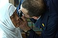US Navy 050211-N-8796S-120 Lt. Robert Senko, an optometrist assigned to the Military Sealift Command (MSC) hospital ship USNS Mercy (T-AH 19), checks an Indonesian woman for cataracts at the University Hospital in Banda Aceh, I.jpg